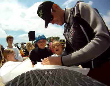 Gary Burtka signs autographs for kids.